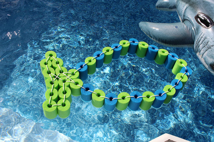 DIY-Pool-Noodle-Fish-Float-With-Headrest-in-the-pool